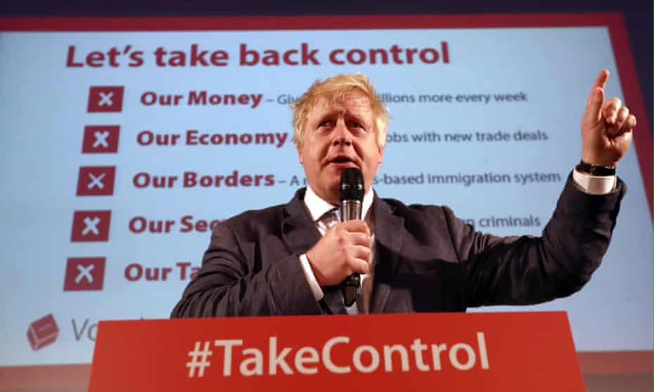 Boris Johnson stands behind #takecontrol  at a Vote Leave rally in 2016 in London.