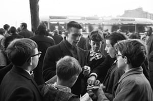 """Roald """"Kniksen"""" Jensen signs autographs for some young fans in January 1965"""