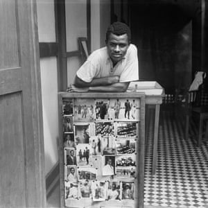 Portrait of James Barnor in front of some of his photographs, in Accra, Ghana, circa 1952.