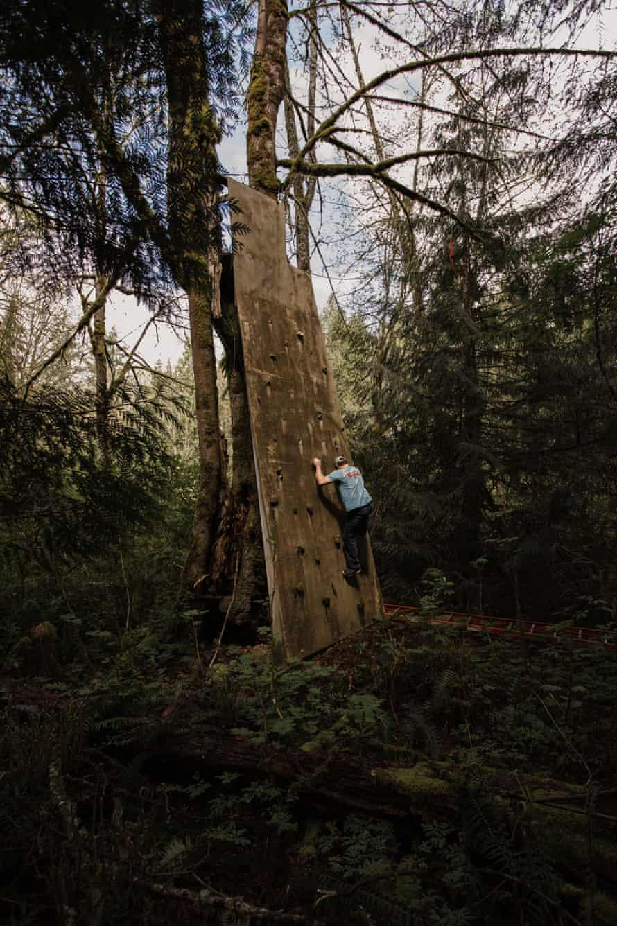 A climbing wall at the main ReStart campus, deep in the woods.