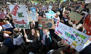 Pupils taking part in a global climate strike outside the Scottish parliament in Edinburgh in March.