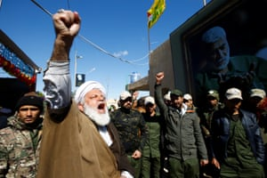 An Iranian cleric pays tribute at the Valley of Peace cemetery in Najaf.