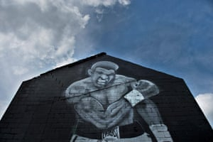 A mural with the image of boxing legend Muhammad Ali is seen on June 4, 2016 in Louisville, Kentucky. Ali, the three-time world heavyweight champion and colorful civil rights activist whose fame transcended the world of sports and made him an iconic figure of the 20th century, has died age 74 after a long battle with Parkinson's disease