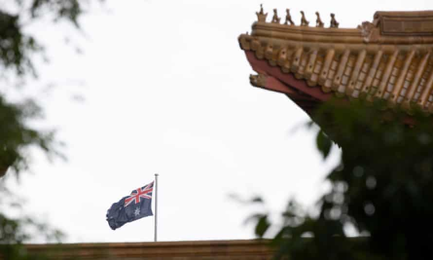 Australian flag as seen behind the roof of the China embassy