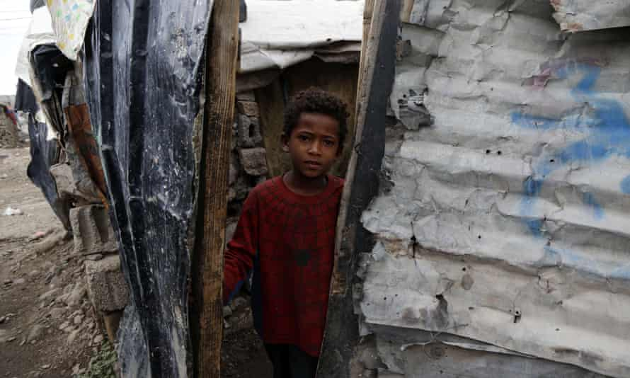 A child looks out of a slum in Sanaa, Yemen, one of the countries most at risk from famine in 2020, according to the World Food Programme.
