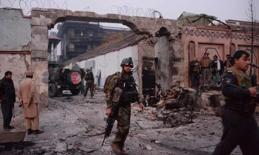Afghan security forces inspect the site of the attack on British charity Save the Children's office