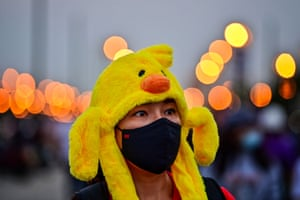 A pro-democracy protester wears a duck-themed hat