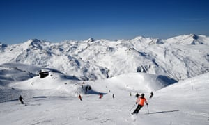 People skiing the slopes of Les Menuires.