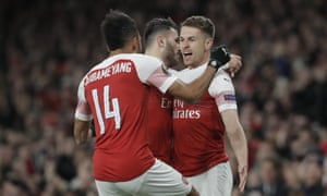 Ramsey celebrates with Sead Kolasinac and Pierre-Emerick Aubameyang.