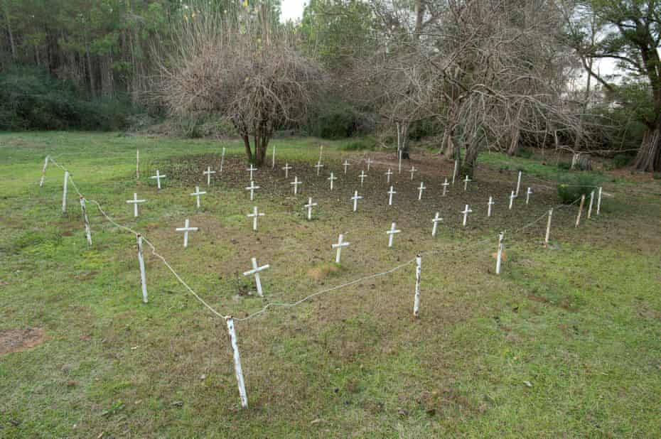White metal crosses mark graves at the cemetery of the former Arthur G Dozier School for Boys in Marianna, Florida, in 2012.