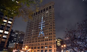 In a show of solidarity with Paris in the wake of the attack, the Flatiron Building, pays tribute to the Eiffel Tower, with a 40 X 100-foot projection of the Eiffel Tower in New York on November 18, 2015. The projected image will feature a banner with the motto of Paris Elle est agitée par les vagues, et ne somber pas which means She is tossed by the waves but does not sink. The projection was created as a collaboration between the Sorgente Group of America and Quantum Electric. AFP PHOTO/ TIMOTHY A. CLARYTIMOTHY A. CLARY/AFP/Getty Images
