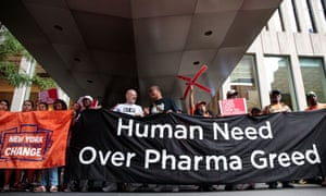 Activists rally during a protest against the price of EpiPens, outside the office of hedge fund manager John Paulson, on 30 August 2016 in New York City.