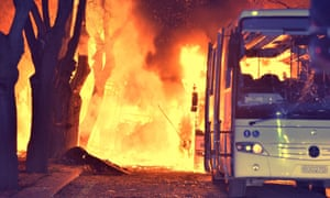 Flames engulf vehicles following a car bomb