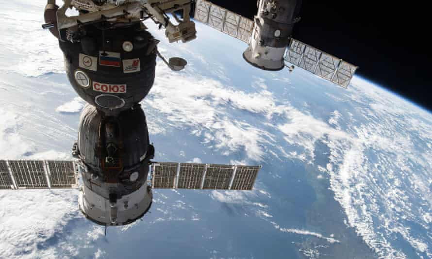 A different Russian Progress cargo craft (R) is seen docked to a spacecraft to supply the International Space Station.