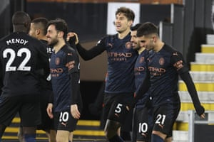 Manchester City's John Stones, centre, celebrates with team mates after scoring his side's opening goal.