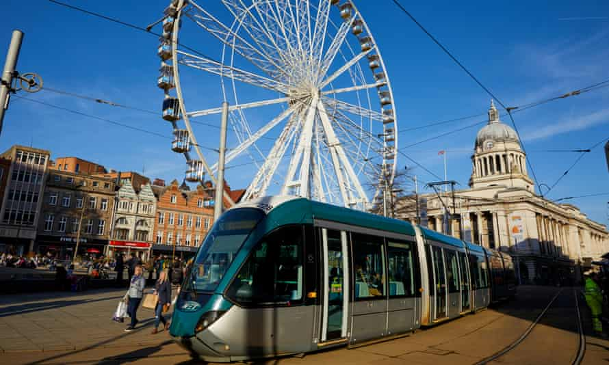 Trams passing the town hall in Nottingham
