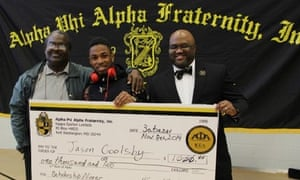 UPO POWER student Jason Goolsby receives a $1,000 scholarship check.