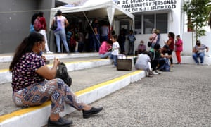Relatives wait for their turn to talk through a computer screen with inmates of the Puente Grande Penitentiary Complex, Mexico, on 11 June 2020.