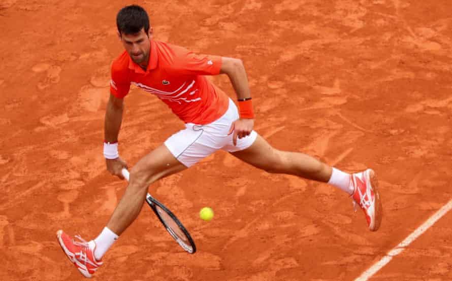 Novak Djokovic plays a shot through his legs against Jan-Lennard Struff.