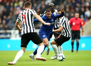 Chelsea's Eden Hazard squeezes past Newcastle's Mohamed Diame, Ciaran Clark and Paul Dummett at St James' Park. Chelsea won the game 2-1, maintaining their winning start to the Premier League season.
