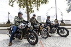 Riders on classic motorcycles with London Eye in background