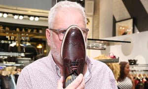 Ray Kelvin holding a shoe in front of his face