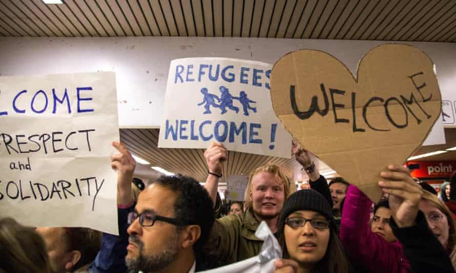 Volunteers welcome refugees arriving at Dortmund central station