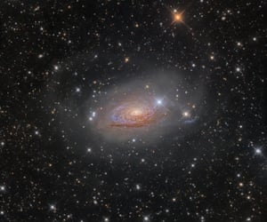 Galaxies Winner: M63 – Star Streams and the Sunflower Galaxy by Oleg Bryzgalov (Ukraine) A bright, spiral galaxy, Messier 63 looks like a star necklace in which the stars have crashed outwards from the galaxy's centre, producing this fantastic long train. The ghostly star arcs of the Sunflower galaxy had long been an elusive target for the photographer, finally shot in one of the darkest places in Europe.Rozhen Observatory, Smolyan Province, Bulgaria, 6 April 2016 10-inch f/3.8 homemade reflector telescope at f/4.4, Whiteswan 180 mount, QSI 583wsg camera, 22-hour total exposure