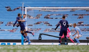 Manchester City's Oleksandr Zinchenko shoulders the ball.