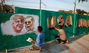 Workers paint Trump and Modi on a wall in Ahmedabad.