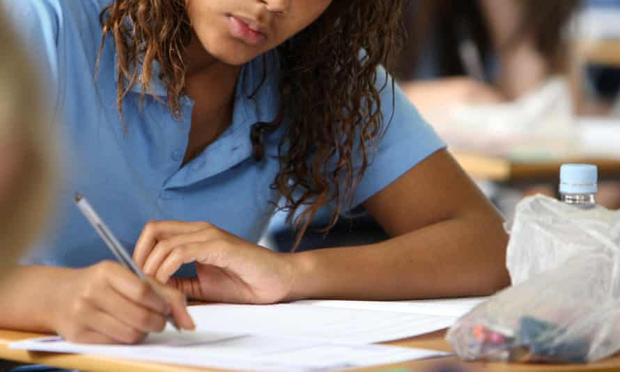 Pupil writing  in an exam