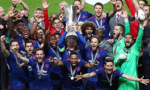 2b9d4b57a97 The Manchester United players with the Europa League trophy after beating  Ajax in the final on