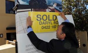 Real estate agent posts 'sold' sticker.