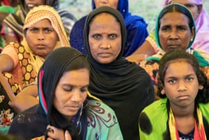 Gond women gather to protest further mining of their Hasdeo Arand forest homes. Their village homes are due to be demolished to make way for the Parsa coal mine.