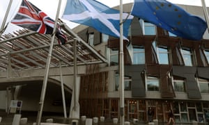 The flags of Britain, Scotland and the EU fly outside the Scottish parliament in Edinburgh