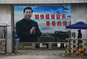 A poster portrait of President Xi outside a military base in in China's southern Guangxi region.