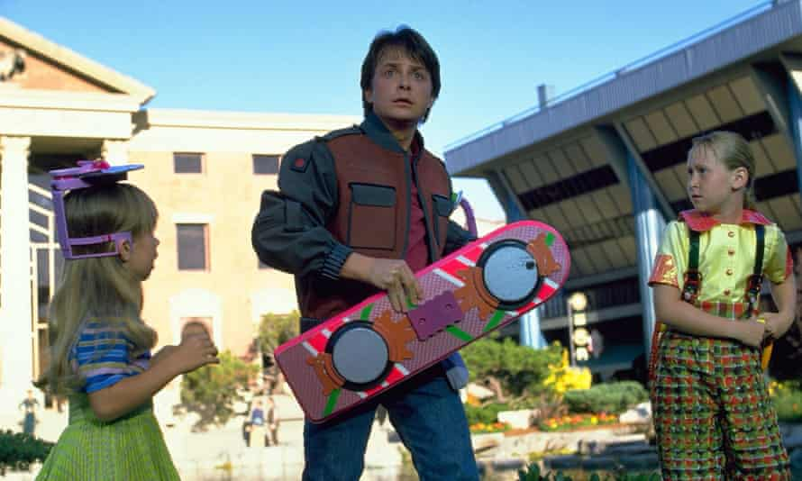Marty McFly clutches his hoverboard in Back to the Future part II