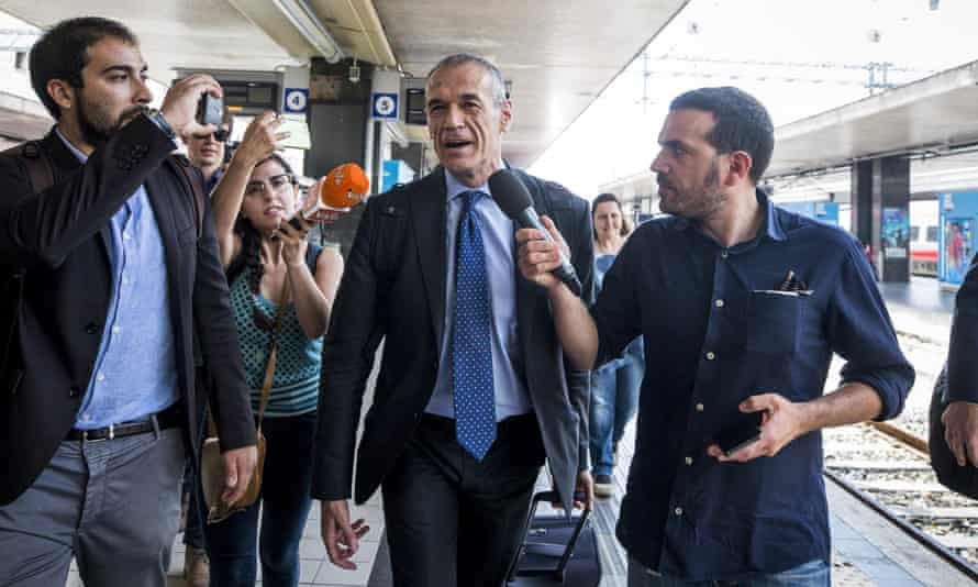 Carlo Cottarelli arrives at Termini railway station in Rome.