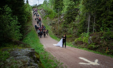 Han leads a procession through Nordmarka forest.