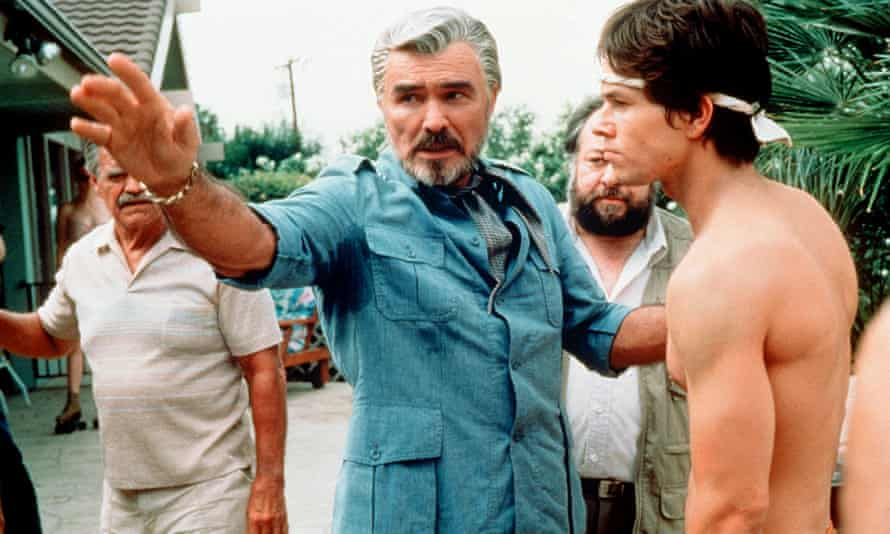 Reynolds with Mark Wahlberg in Boogie Nights.
