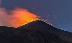 The gorgeous glow … Mount Etna erupts in Catania, Italy on 23 May.