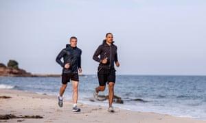 Two men running on a beach