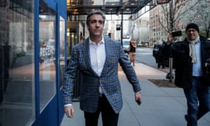 US President Donald Trump's personal lawyer Michael Cohen exits a hotel in New York City