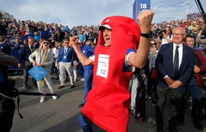 Ian Poulter of Europe wearing a red post box costume