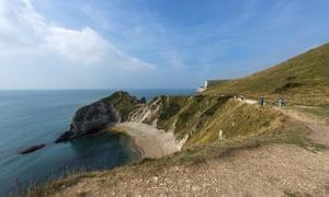 Coastal footpath looking down at the sea on Jurassic Coast, west of Lulworth Cove Dorset, England