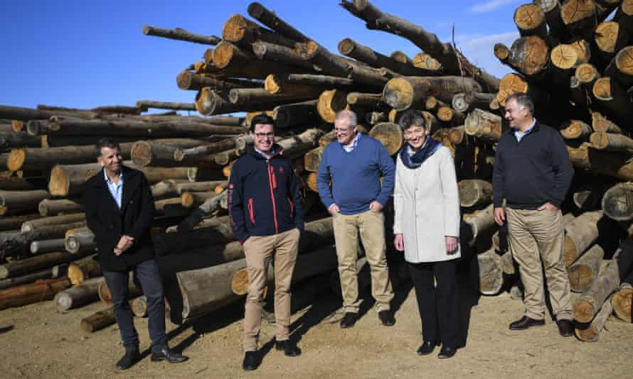 (L-R) NSW transport minister Andrew Constance, federal agriculture minister David Littleproud, PM Scott Morrison, Liberal party candidate for Eden-Monaro Fiona Kotvojs and National party candidate Trevor Hicks pose for photographs in Eden on Tuesday.