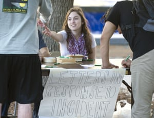 Texas A&M student Hope Beitchman takes letters from students passing by to send to the visiting high school students in response to the incident.