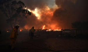 Rural Fire Service crews engage in property protection of a number of homes along the Old Hume Highway