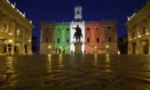 The facade of Rome's Campidoglio Capitol Hill is lit with the colours of the Italian flag