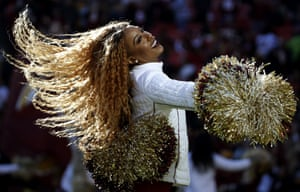 Maryland, USA Washington Redskins cheerleader performs during the first half of an NFL football game against the Detroit Lions, in Landover, Md.